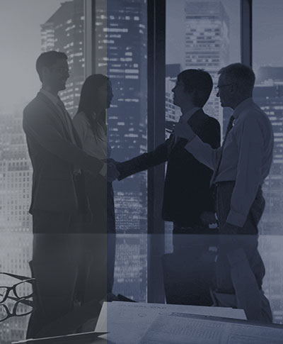 business meeting involving four people with skyscraper background