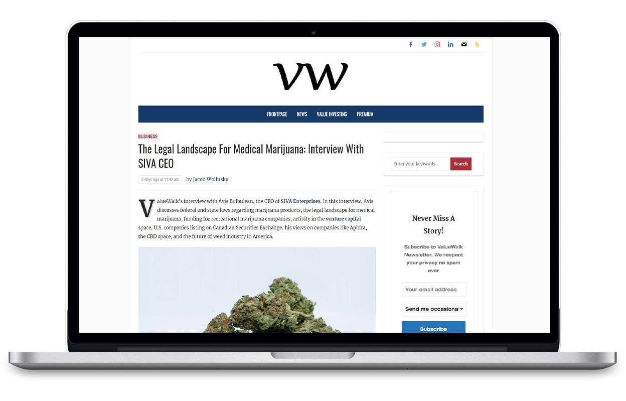 Laptop browsing vw article about Medical Marijuana